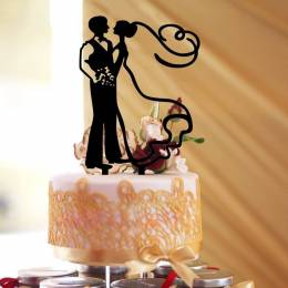 Silhouettes of couple subject to wedding cake