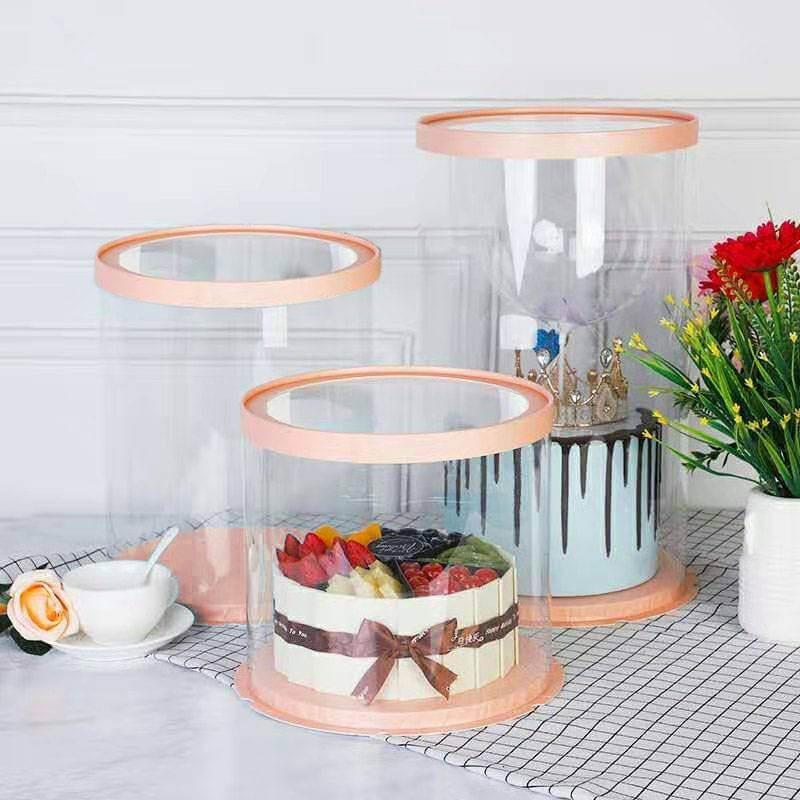 Caja redonda de pastel de oro rosa y transparente