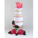 Borde de pastel con lazo de oro rosa en papel de oblea