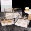 Transparent cupcake box with white ribbon