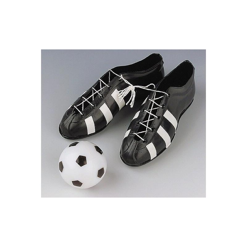 zapatillas y equipo de fútbol